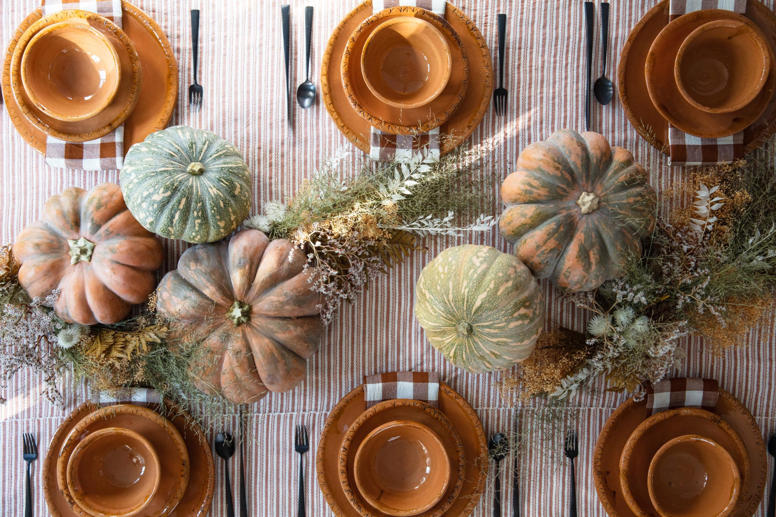 Thanksgiving table setting with linens and decor
