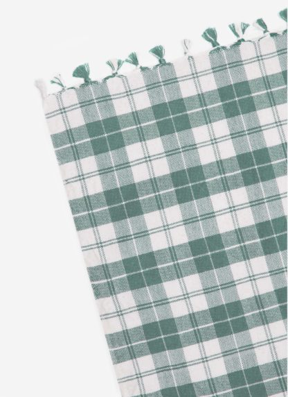 close up of light green plaid with tassels