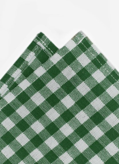 close up shot of gingham green napkin