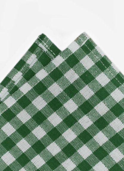 close up shot of gingham green napkin
