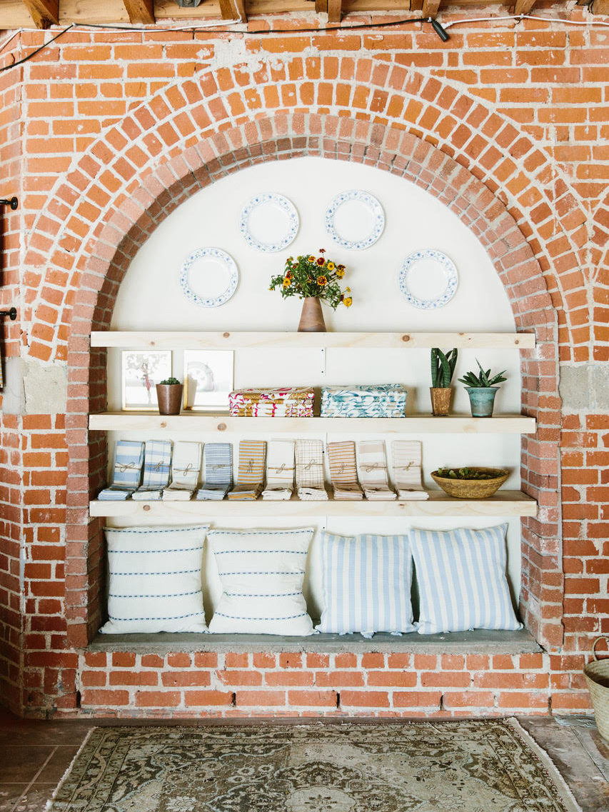 brick display inside the store with napkins and pillows